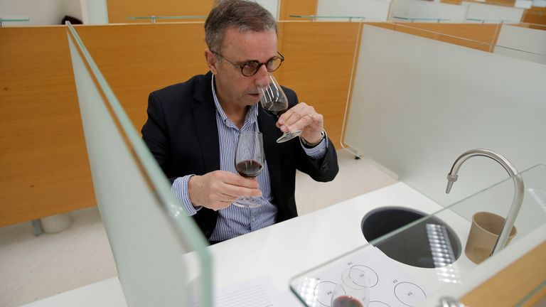 At a one-of-a-kind tasting, 12 connoisseurs sampled one of the space-travelled wines. Pic: AP