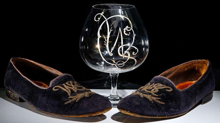 A pair of Winston Churchill's velvet slippers and brandy glass