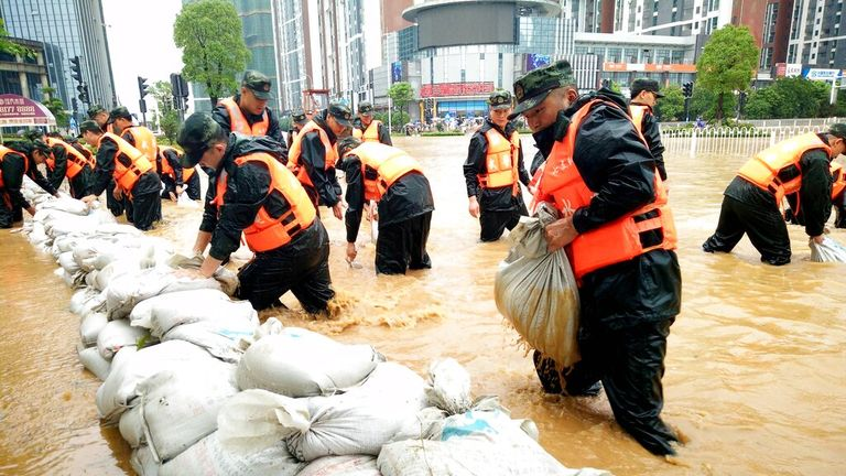 Officials help ease flooding in Wuhan in July 2016