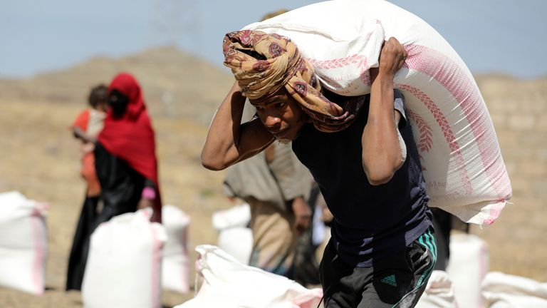 A worker at a camp for internally displaced people on the outskirts of Sanaa, Yemen