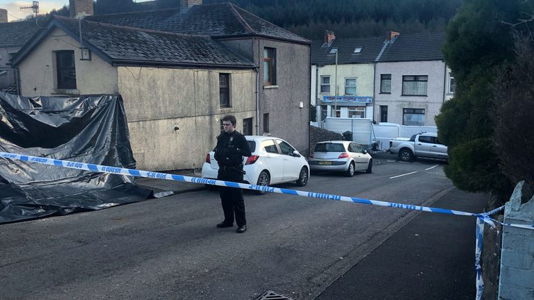 Police at the scene in the village of Ynyswen