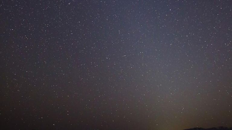 This photo shows the zodiacal light as it appeared on March 1, 2021, in Skull Valley, Utah. The Pleiades star cluster is visible near the top of the light column. Mars is just below that. Credit: NASA/JPL-Caltech