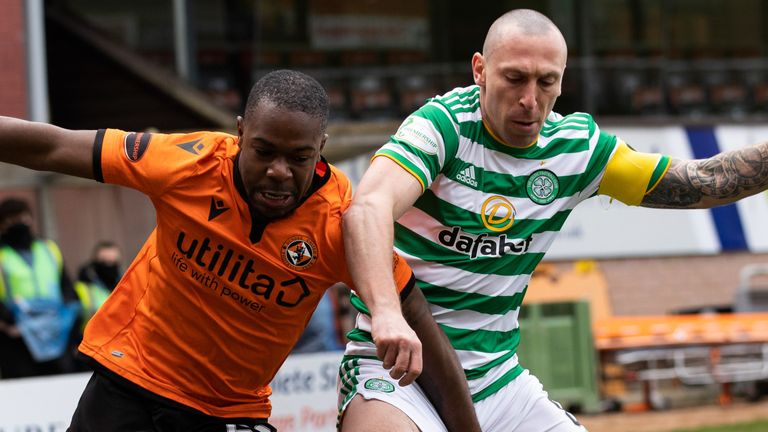 Scott Brown and Jeando Fuchs  battle for possession