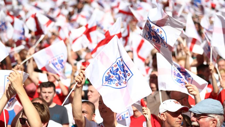 England fans in the stands wave flags at Wembley (PA)