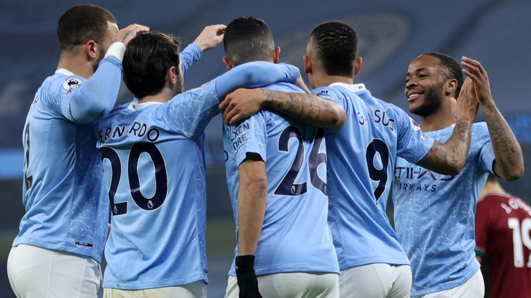 Manchester City players celebrate taking the lead against Wolves