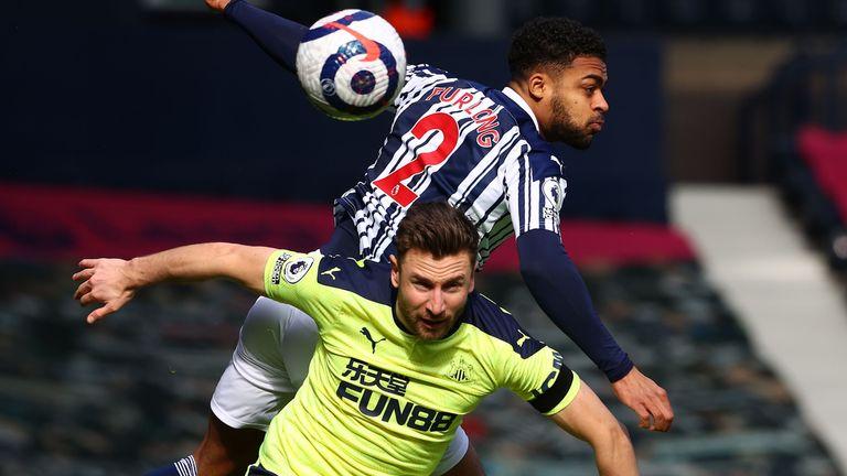 Darnell Furlong goes airborne to challenge Paul Dummett