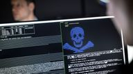"""04 December 2019, Hessen, Darmstadt: IT security scientists are training in the """"Cyber Range"""" room in the new """"Athene"""" cyber security centre how infiltrated blackmail programs (""""Ransomware"""") can be rendered harmless. The national research institute of the Fraunhofer-Gesellschaft, the Technical University and the Darmstadt University of Applied Sciences, which has been in existence since the beginning of the year, is intended to help ensure security and the protection of privacy in the face of in"""