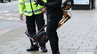 An e-scooter rider is stopped by a police officer in Islington, London