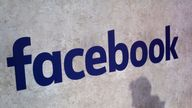 FILE - This Jan. 17, 2017, file photo shows a Facebook logo displayed in a start-up companies gathering at Paris' Station F in Paris. Facebook CEO Mark Zuckerberg will meet Friday May 10, 2019 French President Emmanuel Macron as the tech giant and France try to pioneer ways of fighting hate speech and violent extremism online. (AP Photo/Thibault Camus, File)