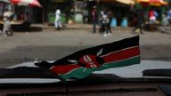 A flag of Kenya is pictured from the inside of a car in the slum area of Mathare in the capital Nairobi, Kenya, October 29, 2017. REUTERS/Siegfried Modola