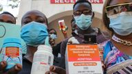 People in Mombasa hold empty containers during a demonstration over shortages of HIV drugs. Pic: AP