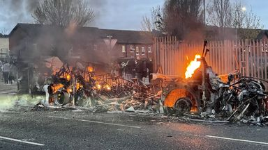 The wreckage of the bus set on fire in Belfast