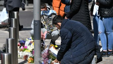 People place flowers at the scene of the murder of 14-year-old Fares Maatou  in Barking Road, East Ham