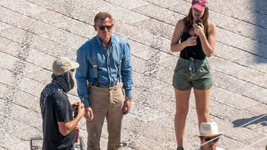In this Sept. 12, 2019 photo, actor Daniel Craig, second from left, is seen on the set of the latest James Bond movie 'No time to die' in Matera, southern Italy. The film is due out in spring 2020. (AP Photo/Fabio Dell'Aquila)