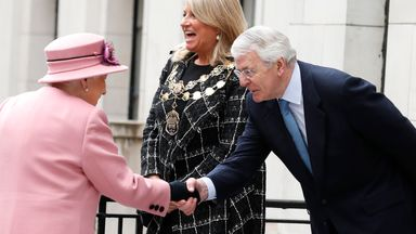 Sir John Major takes the Queen's hand at King's College in London in 2019