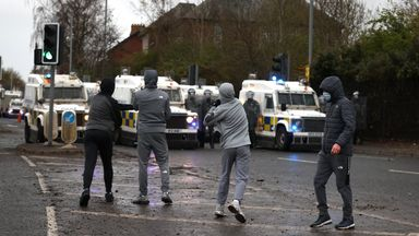 Youths throw stones towards PSNI officers on the Springfield road, during further unrest in Belfast. Picture date: Thursday April 8, 2021.