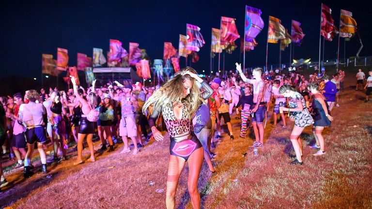 Revelers dance in the Temple Field at Bestival at the Lulworth Estate in Dorset.