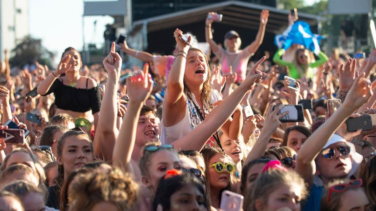 Fans watch Lewis Capaldi perform on the Main Stage during the TRNSMT festival at Glasgow Green, Scotland.
