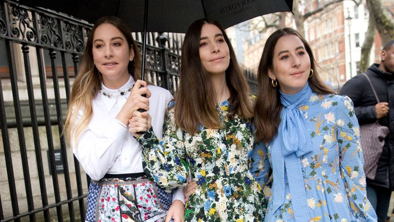Este Haim, left, Alana Haim, and Danielle Haim of music band Haim arrive before the Erdem Autumn/Winter 2018 London Fashion Week show held at the National Portrait Gallery, London. PRESS ASSOCIATION. Picture date: Monday February 19, 2018. Photo credit should read: Isabel Infantes/PA Wire