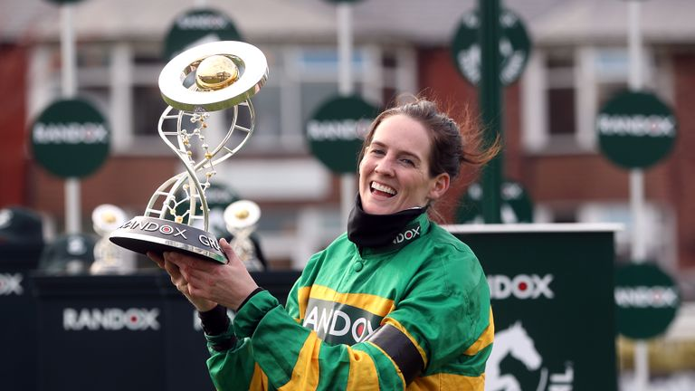 Jockey Rachael Blackmore receives the Randox Grand National Handicap Chase trophy after winning on Minella Times during Grand National Day of the 2021 Randox Health Grand National Festival at Aintree Racecourse, Liverpool. Picture date: Saturday April 10, 2021.