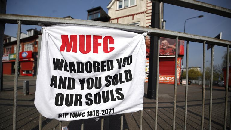 A banner left by Manchester United fans objecting to the clubs decision to join the European Super League, Sir Matt Busby Way, Manchester. Picture date: Tuesday April 20, 2021.