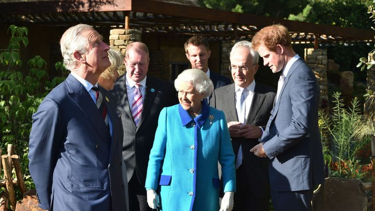 The Prince of Wales (left), Queen Elizabeth II and Prince Harry (right), in the Sentebale Garden, with Philip Green (second right) and David Brownlow (third left), who are main supporters of the Lesotho Sentabale Charity and the Chelsea Garden and the Garden's designer Matt Keightlry (rear) at the annual Chelsea Flower show at Royal Hospital Chelsea in London.