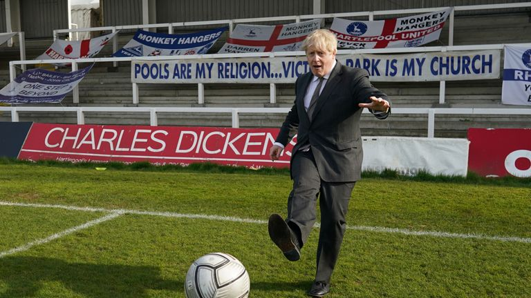 Prime Minister Boris Johnson kicks a football during a visit to the Hartlepool United Football Club, in Hartlepool, ahead of the May 6 by-election. Picture date: Friday April 23, 2021.