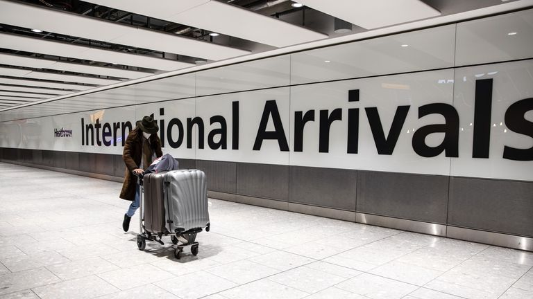Passenger wearing a face mask arrives at the Heathrow international arrival hall. (Photo by May James / SOPA Images/Sipa USA)