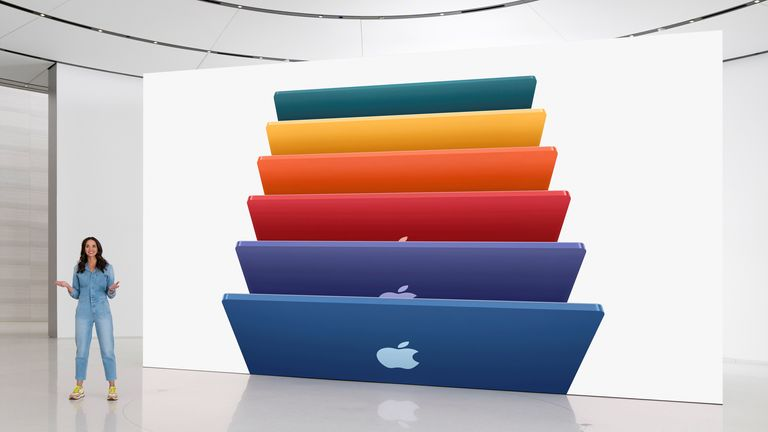 Apple's Colleen Novielli showcases the new iMac lineup featuring an array of colors in Cupertino, California