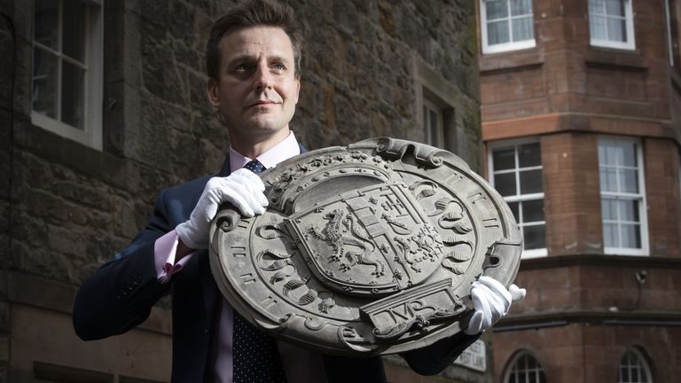 Head of House Sales Charlie Thomson holds one of four carved oak armorial panels from The Queen Regent's House, Blythe's Close, Edinburgh, which shows the impaled arms of King James V of Scotland and Mary Guise (the parents of Mary Queen of Scots). The armorial panels sold at auction for £17,750 at the Bonhams Edinburgh Dunrobin Attic Sale, an auction of hundreds of items found in the attics and cellars at Dunrobin Castle in Sutherland, the family seat of the 25th Earl of Sutherland.