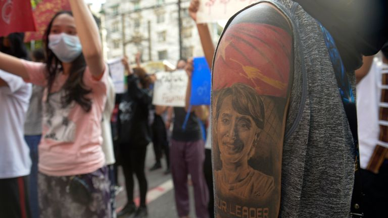 A Protester shoe his arm with drawing of ousted Myanmar leader Aung San Suu Kyi as they anti coup protesters march in Yangon, Myanmar, Saturday, April 10, 2021. Security forces in Myanmar cracked down heavily again on anti-coup protesters Friday even as the military downplayed reports of state violence.(AP Photo)
