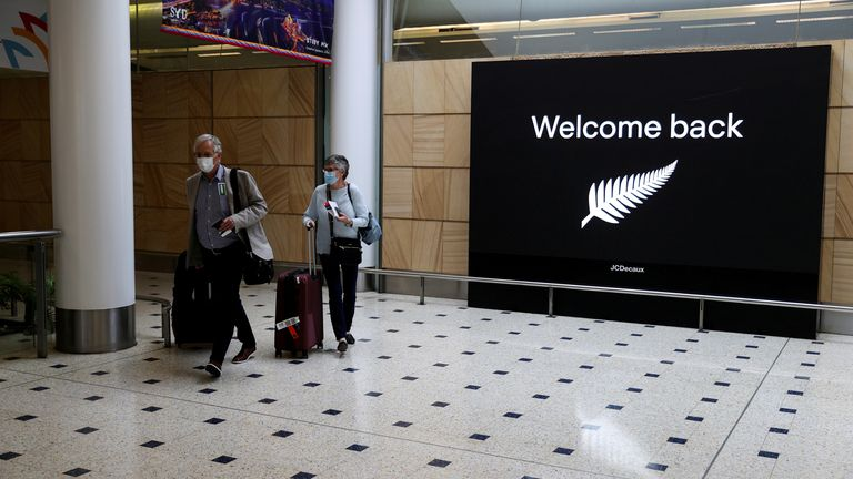 Passengers arrive from New Zealand after the Trans-Tasman travel bubble opened overnight
