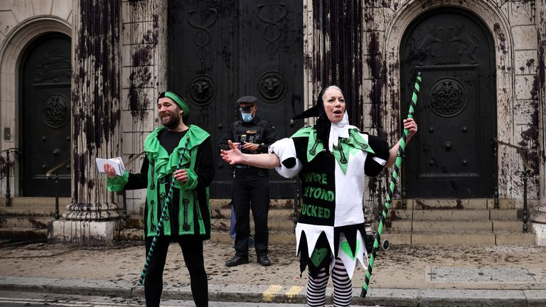 SENSITIVE MATERIAL. THIS IMAGE MAY OFFEND OR DISTURB Activists from the Extinction Rebellion, a global environmental movement, protest outside the Bank of England, in London, Britain, April 1, 2021. REUTERS/Henry Nicholls
