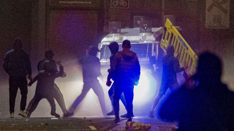 Rioters clash with police in the Sandy Row area of Belfast. Picture date: Friday April 2, 2021.