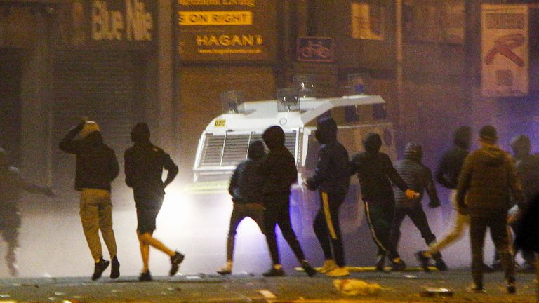 Rioters clash with police in the Sandy Row area of Belfast