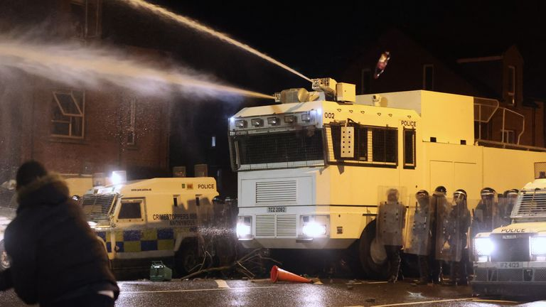 Police use water cannon to disperse rioters in Belfast earlier this month