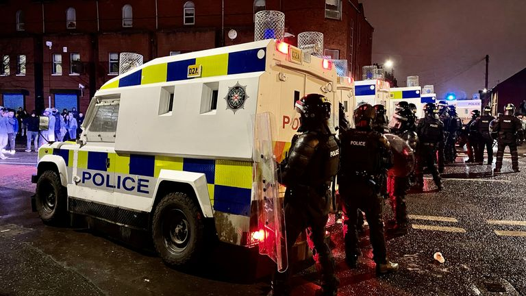 PSNI officers on the nationalist side of the Springfield Road in Belfast on Wednesday