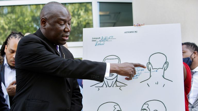 Ben Crump points to a diagram of the fatal gunshot in the back of Andrew Brown Jr's head following the findings of an independent post-mortem