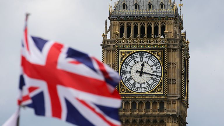 A British national flag flies in front of the Big Ben clock tower in London, Britain, 24 June 2016. In a referendum on 23 June, Britons have voted by a narrow margin to leave the European Union (EU). Photo by: Michael Kappeler/picture-alliance/dpa/AP Images