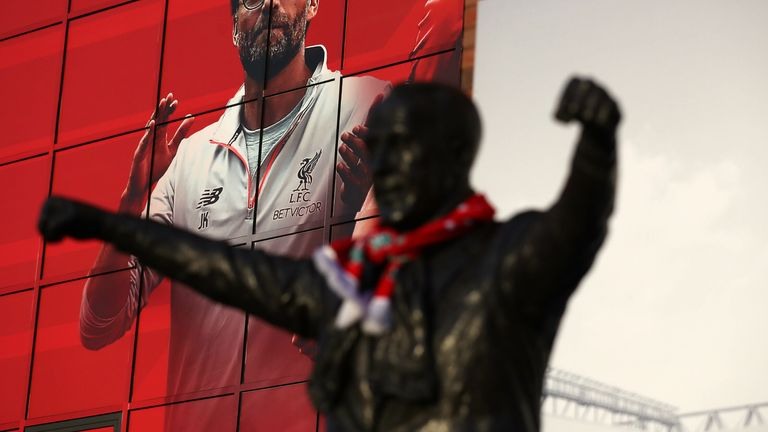 The Bill Shankly statue outside Anfield in 2016 in front of a picture of current manager Jurgen Klopp