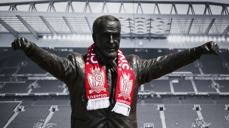 The statue of legendary Liverpool manager Bill Shankly outside Anfield with a team scarf after Liverpool won the Premier League in 2020