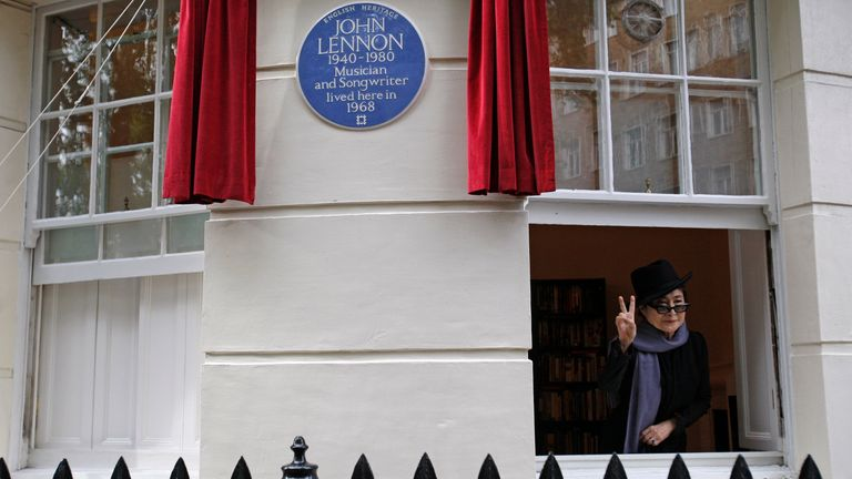 Japanese artist and musician Yoko Ono poses by a plaque erected to British musician John Lennon during an unveiling ceremony at 34 Montagu Square in London, Saturday, Oct. 23, 2010. John Lennon is commemorated with an English Heritage blue plaque in celebration of his life and contribution to music at the flat where he shared his first home with Yoko Ono and where the famous nude photograph of John and Yoko was taken for the 'Two Virgins' album cover. (AP Photo/Sang Tan)