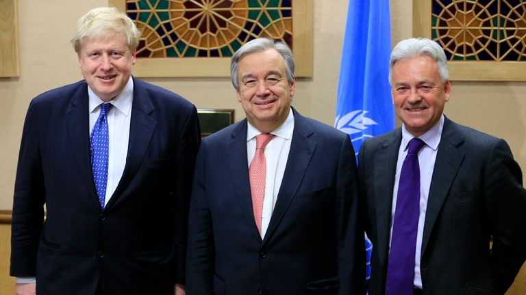 British Foreign Secretary Johnson poses with UN Secretary General Guterres and British Minister of State for Foreign Affairs Duncan after a meeting aside of the Conference on Cyprus in Geneva