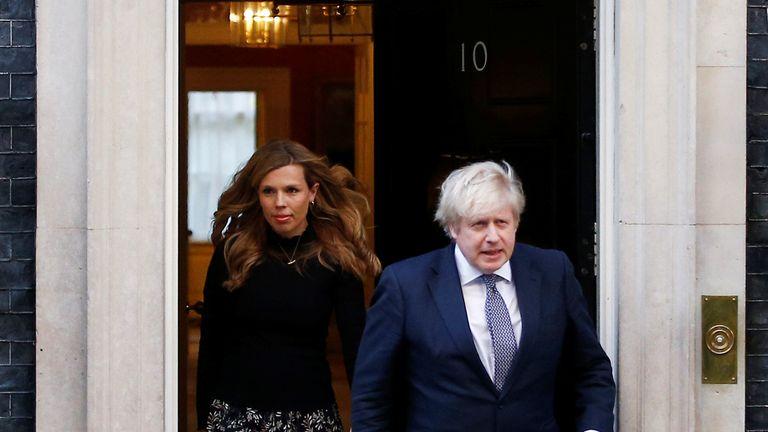 Britain's Prime Minister Boris Johnson and partner Carrie Symonds outside 10 Downing Street