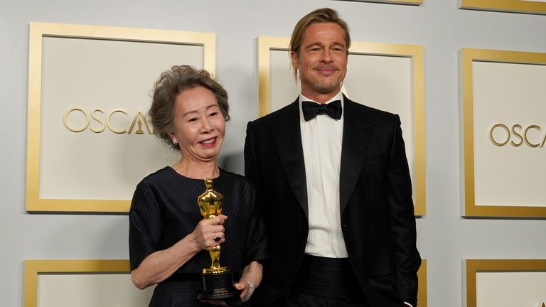"Brad Pitt, right, poses with Yuh-Jung Youn, winner of the award for best actress in a supporting role for ""Minari,"" in the press room at the Oscars on Sunday, April 25, 2021, at Union Station in Los Angeles. (AP Photo/Chris Pizzello, Pool)"