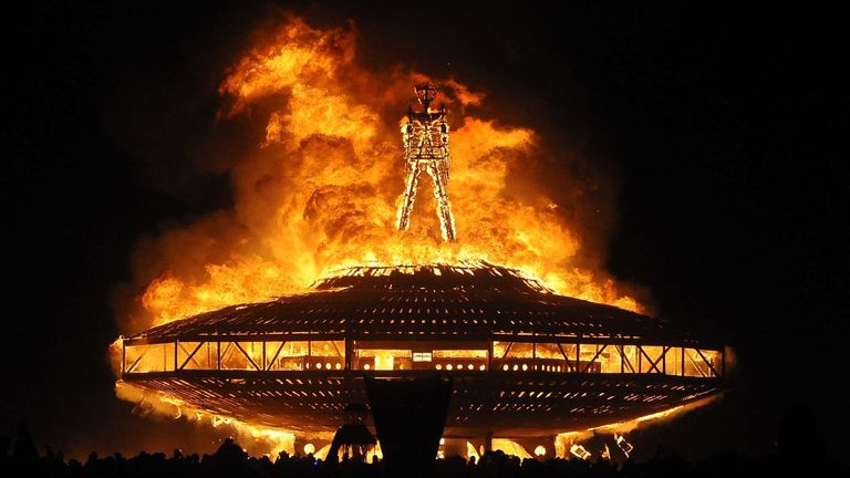 At Burning Man, a giant wooden man is literally burned. Pic: AP