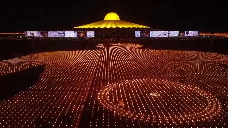 300,000 candles are lit at Thai Temple to mark Earth Day