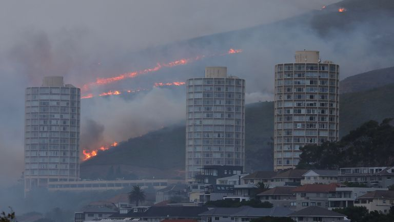Flames are seen close to the city fanned by strong winds after a fire broke out on the slopes of Table Mountain in Cape Town
