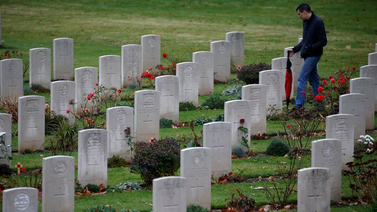 A man looks at graves at the cemetery at the Franco-British National Memorial in Thiepval, near Amiens, France, November 7, 2018