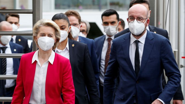 Ursula von der Leyen and Charles Michel arrive at a news conference after the meeting